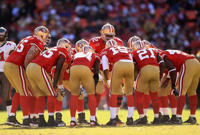 SAN FRANCISCO - NOVEMBER 21:  The San Francisco 49ers offense huddles together during their game against the Tampa Bay Buccaneers at Candlestick Park on November 21, 2010 in San Francisco, California.  (Photo by Ezra Shaw/Getty Images)