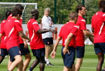 ST ALBANS, ENGLAND - AUGUST 05: Manager of Arsenal Arsene Wenger  watches his players during a training session at London Colney on August 5, 2011 in St Albans, England. (Photo by Tom Dulat/Getty Images)