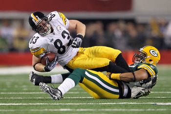 ARLINGTON, TX - FEBRUARY 06: Heath Miller #83 of the Pittsburgh Steelers is tackled after a catch by Desmond Bishop #55 of the Green Bay Packers during Super Bowl XLV at Cowboys Stadium on February 6, 2011 in Arlington, Texas.  (Photo by Jamie Squire/Gett