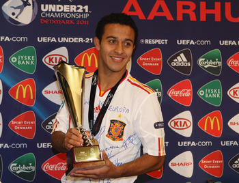 ARHUS, DENMARK - JUNE 25:  Thiago Alcantara of Spain poses with the Carlsberg man of the match after the UEFA European Under-21 Championship Final match between Spain and Switzerland at the Arhus Stadium on June 25, 2011 in Arhus, Denmark.  (Photo by Mich