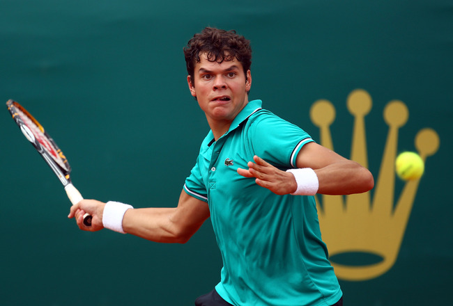 MONACO - APRIL 10:  Milos Raonic of Canada plays a forehand in his match against Michael Llodra of France during Day One of the ATP Masters Series Tennis at the Monte Carlo Country Club on April 10, 2011 in Monte Carlo, Monaco.  (Photo by Julian Finney/Ge