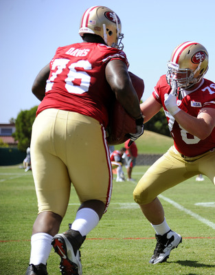 SANTA CLARA, CA - JULY 30: Mike Person #78, Kenny Wiggins #65 and Anthony Davis #76 of the San Francisco 49ers participate in drills during practice at the San Francisco 49ers training facility on July 30, 2011 in Santa Clara, California. (Photo by Thearo