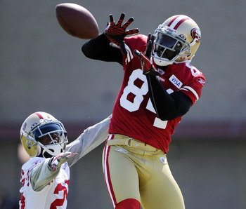 SANTA CLARA, CA - JULY 30: Josh Morgan #84 of the San Francisco 49ers goes up to catch a pass over Tarell Brown #25 during practice at the San Francisco 49ers training facility on July 30, 2011 in Santa Clara, California. (Photo by Thearon W. Henderson/Ge