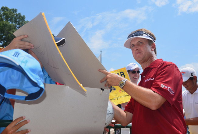 JOHNS CREEK, GA - AUGUST 08:  David Toms signs autugraphs for fans during a practice round prior to the start of the 93rd PGA Championship at the Atlanta Athletic Club on August 8, 2011 in Johns Creek, Georgia.  (Photo by Stuart Franklin/Getty Images)