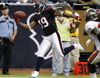 HOUSTON - SEPTEMBER 02:  Wide receiver Dorin Dickerson #19 of the Houston Texans makes a one handed catch in the fourth quarter against the Tampa Bay Buccaneers as safety Vince Anderson #37 moves in on the play at Reliant Stadium on September 2, 2010 in H