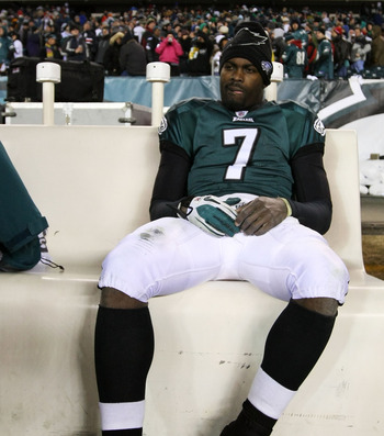 PHILADELPHIA, PA - JANUARY 09:  Michael Vick #7 of the Philadelphia Eagles sits on the bench after losing to the Green Bay Packers during the 2011 NFC wild card playoff game at Lincoln Financial Field on January 9, 2011 in Philadelphia, Pennsylvania.  (Ph