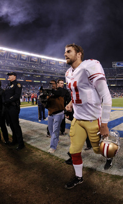 SAN DIEGO, CA - DECEMBER 16:  Quarterback Alex Smith #11 of the San Francisco 49ers jogs off the field after losing to the San Diego Chargers 34-7 at Qualcomm Stadium on December 16, 2010 in San Diego, California.  (Photo by Harry How/Getty Images)