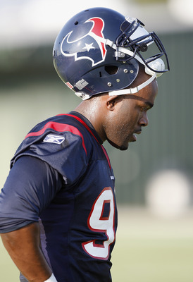HOUSTON, TX - AUGUST 01:  Outside linebacker Mario Williams #90 of  the Houston Texans during a break in practice on the first day of training camp at Reliant Park on August 1, 2011 in Houston, Texas. Temperatures are expected to be in triple digits all w