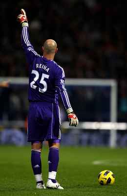 BOLTON, ENGLAND - OCTOBER 31:   Pepe Reina of Liverpool gestures during the Barclays Premier League match between Bolton Wanderers and Liverpool at the Reebok Stadium on October 31, 2010 in Bolton, England.  (Photo by Clive Brunskill/Getty Images)