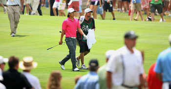 WHITE SULPHUR SPRINGS, WV - JULY 31: Anthony Kim and his caddie walk down the second fairway during the final round of The Greenbrier Classic at The Old White TPC on July 31, 2011 in White Sulphur Springs, West Virginia. (Photo by Hunter Martin/Getty Imag