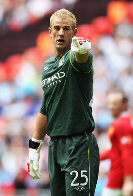 LONDON, ENGLAND - AUGUST 07:  Joe Hart of Manchester City gestures during the FA Community Shield match sponsored by McDonald's between Manchester City and Manchester United at Wembley Stadium on August 7, 2011 in London, England.  (Photo by Clive Rose/Ge