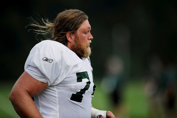 FLORHAM PARK, NJ - AUGUST 07:  Nick Mangold #74 takes part in the afternoon practice at NY Jets Practice Facility on August 7, 2011 in Florham Park, New Jersey.  (Photo by Patrick McDermott/Getty Images)