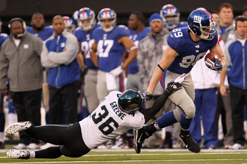 EAST RUTHERFORD, NJ - NOVEMBER 28:  Kevin Boss #89 of the New York Giants beats the tackle of Courtney Greene #36 of the Jacksonville Jaguars to score the winning touchdown at New Meadowlands Stadium on November 28, 2010 in East Rutherford, New Jersey.  (