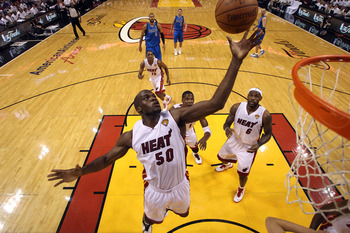 MIAMI, FL - JUNE 12:  Joel Anthony #50 of the Miami Heat controls a rebound against Dallas Mavericks in Game Six of the 2011 NBA Finals at American Airlines Arena on June 12, 2011 in Miami, Florida. The Mavericks won 105-95. NOTE TO USER: User expressly a