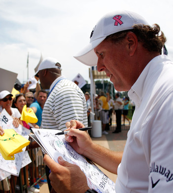 JOHNS CREEK, GA - AUGUST 09:  Phil Mickelson signs autographs for fans during a practice round prior to the start of the 93rd PGA Championship at the Atlanta Athletic Club on August 9, 2011 in Johns Creek, Georgia.  (Photo by Mike Ehrmann/Getty Images)