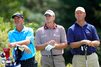 JOHNS CREEK, GA - AUGUST 09:   Jerry Kelly (L)Steve Stricker (C) and  Mike Small (R) wait on a tee  during a practice round prior to the start of the 93rd PGA Championship at the Atlanta Athletic Club on August 9, 2011 in Johns Creek, Georgia.  (Photo by