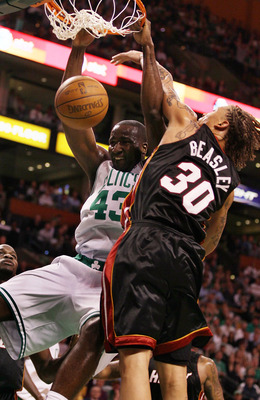 BOSTON - APRIL 27:  Kendrick Perkins #43 of the Boston Celtics dunks the ball as Michael Beasley #30 of the Miami Heat defends during Game Five of the Eastern Conference Quarterfinals of the 2010 NBA playoffs at the TD Garden on April 27, 2010 in Boston,