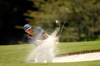 JOHNS CREEK, GA - AUGUST 10:  Dustin Johnson hits a shot from bunker during a practice round prior to the start of the 93rd PGA Championship at the Atlanta Athletic Club on August 10, 2011 in Johns Creek, Georgia.  (Photo by Mike Ehrmann/Getty Images)