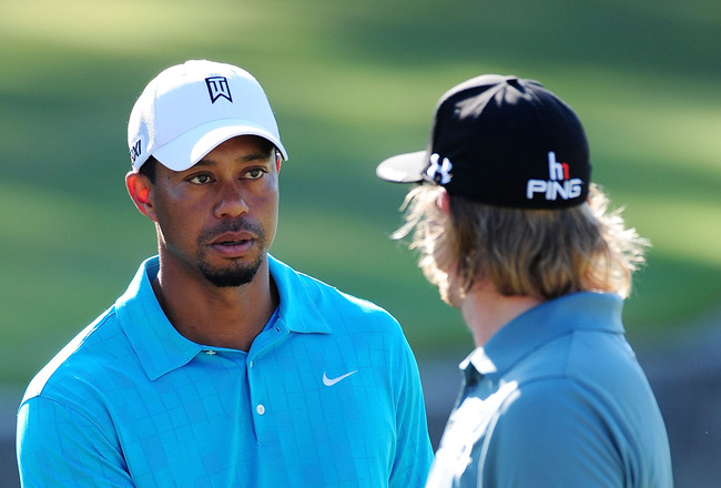 JOHNS CREEK, GA - AUGUST 10:  Tiger Woods (L) and Hunter Mahan (R) shake hands during a practice round prior to the start of the 93rd PGA Championship at the Atlanta Athletic Club on August 10, 2011 in Johns Creek, Georgia.  (Photo by Stuart Franklin/Gett