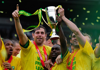 NORWICH, ENGLAND - MAY 07:  Norwich City captain Grant Holt celebrates promotion during the npower Championship match between Norwich City and Coventry City at Carrow Road on May 7, 2011 in Norwich, England.  (Photo by Jamie McDonald/Getty Images)