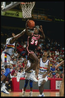 Guard Willie Burton of the Miami Heat goes up for two during a game against the Denver Nuggets at the McNichols Arena in Denver, Colorado.