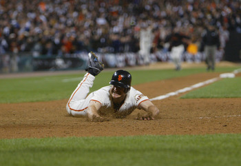SAN FRANCISCO - OCTOBER 14:  Third baseman David Bell #28 of the San Francisco Giants slides into home plate with the game-winning run to end game five of the National League Championship Series against the St. Louis Cardinals on October 14, 2002 at Pacif