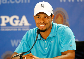 JOHNS CREEK, GA - AUGUST 10:  Tiger Woods talks with the media during a press conference after his practice round prior to the start of the 93rd PGA Championship at the Atlanta Athletic Club on August 10, 2011 in Johns Creek, Georgia.  (Photo by Mike Ehrm