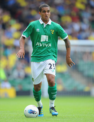 NORWICH, ENGLAND - AUGUST 06: Kyle Naughton of Norwich in action during the Pre-Season Friendly match between Norwich City FC and FC Parma at Carrow Road on August 6, 2011 in Norwich, England.  (Photo by Michael Regan/Getty Images)