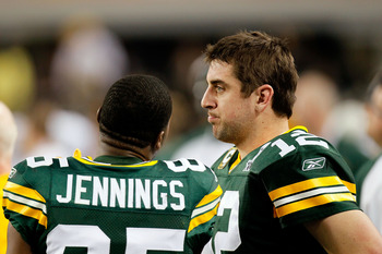 ARLINGTON, TX - FEBRUARY 06:  Quarterback Aaron Rodgers #12 and Greg Jennings #85 of the Green Bay Packers talk on the sideline against the Pittsburgh Steelers during Super Bowl XLV at Cowboys Stadium on February 6, 2011 in Arlington, Texas.  (Photo by Ke
