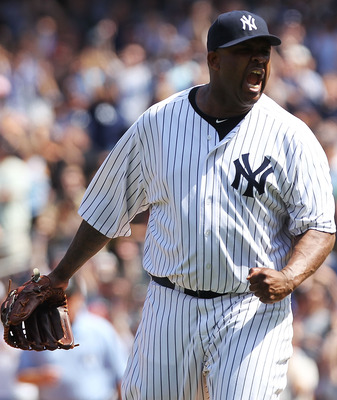 NEW YORK, NY - JULY 10:  CC Sabathia #52 of the New York Yankees celebrates pitching a complete game against the Tampa Bay Rays at Yankee Stadium on July 10, 2011 in the Bronx borough of New York City.  (Photo by Nick Laham/Getty Images)