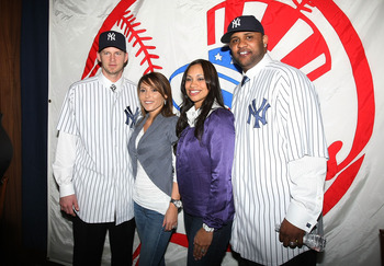NEW YORK - DECEMBER 18: (L-R)  A.J. Burnett, his wife Karen, CC Sabathia's wife Amber and CC Sabathia pose for photographers during a press conference to announce their signing to the New York Yankees at Yankee Stadium on December 18, 2008  in the Bronx b