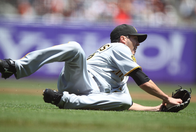 SAN FRANCISCO, CA - AUGUST 10:  Jeff Karstens #27 of the Pittsburgh Pirates fields a ball hit by Andres Torres #56 of the San Francisco Giants in the first inning at AT&amp;T Park on August 10, 2011 in San Francisco, California.  (Photo by Jed Jacobsohn/Getty