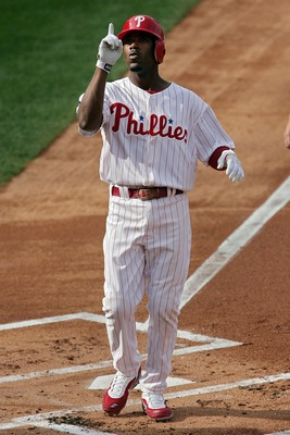 PHILADELPHIA - OCTOBER 04:  Jimmy Rollins #11 of the Philadelphia Phillies celebrates after hitting a solo home run in the first inning against the Colorado Rockies during Game Two of the National League Divisional Series at Citizens Bank Park on October
