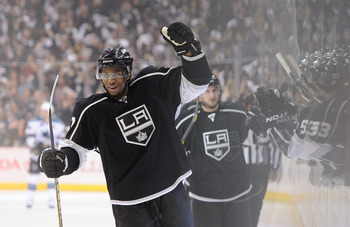 LOS ANGELES, CA - APRIL 19:  Wayne Simmonds #17 of the Los Angeles Kings celebrates after an assist on a goal by Kyle Clifford #13 against the San Jose Sharks in game three of the Western Conference Quarterfinals during the 2011 NHL Stanley Cup Playoffs a