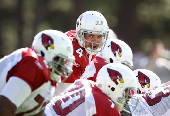FLAGSTAFF, AZ - AUGUST 04:  Quarterback Kevin Kolb #4 of the Arizona Cardinals prepares to snap the ball during the team training camp at Northern Arizona University on August 4, 2011 in Flagstaff, Arizona.  (Photo by Christian Petersen/Getty Images)