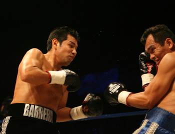 CHENGDU, CHINA - NOVEMBER 7: (CHINA OUT) Marco Antonio Barrera (L) of Mexico and Samuel Ventura Alvarez of Mexico fight during a WBC lightweight attraction at the 2008 WBC World Championship Boxing on November 7, 2008 in Chengdu of Sichuan Province, China