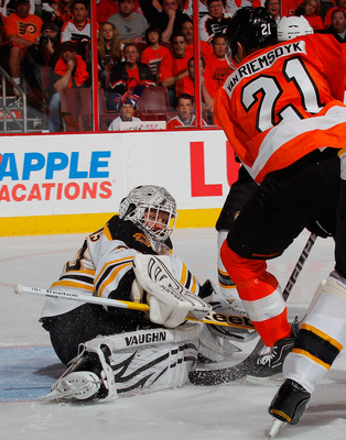 PHILADELPHIA, PA - MAY 02:  Goalie Tim Thomas #30 of the Boston Bruins stops a shot by James van Riemsdyk #21 of the Philadelphia Flyers during the second period of Game Two of the Eastern Conference Semifinals during the 2011 NHL Stanley Cup Playoffs at