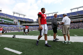 BALTIMORE, MD - AUGUST 06:  Joe Flacco #5 of the Baltimore Ravens walks on the field during training camp at M&T Bank Stadium on August 6, 2011 in Baltimore, Maryland.  (Photo by Rob Carr/Getty Images)