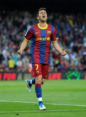 BARCELONA, SPAIN - APRIL 23:  David Villa of Barcelona celebrates scoring his sides opening goal during the la Liga match between Barcelona and Osasuna at the Camp Nou stadium on April 23, 2011 in Barcelona, Spain.  (Photo by Jasper Juinen/Getty Images)