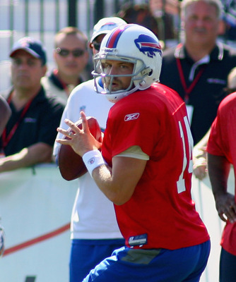 PITTSFORD, NY - AUGUST 08:  Ryan Fitzpatrick #14 of the Buffalo Bills looks to pass during Buffalo Bills Training Camp at St. John Fisher College on August 8, 2011 in Pittsford, New York.  (Photo by Rick Stewart/Getty Images)