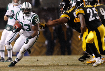 PITTSBURGH - DECEMBER 19:  Shonn Greene #23 of the New York Jets runs by the Pittsburgh Steelers defense during the game on December 19, 2010 at Heinz Field in Pittsburgh, Pennsylvania.  (Photo by Jared Wickerham/Getty Images)