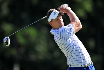 JOHNS CREEK, GA - AUGUST 10:  Luke Donald of England watches a shot during a practice round prior to the start of the 93rd PGA Championship at the Atlanta Athletic Club on August 10, 2011 in Johns Creek, Georgia.  (Photo by Stuart Franklin/Getty Images)