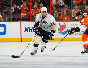 PHILADELPHIA, PA - MARCH 24:  Maxime Talbot #25 of the Pittsburgh Penguins skates with the puck during a game against the Philadelphia Flyers on March 24, 2011 at the Wells Fargo Center in Philadelphia, Pennsylvania.  (Photo by Lou Capozzola/Getty Images)