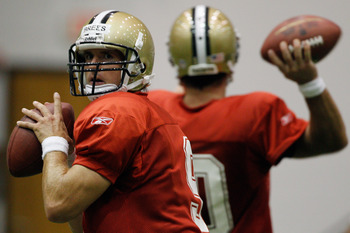 METAIRIE, LA - AUGUST 05:  Quarterback Drew Brees #9 of the New Orleans Saints works out during practice at the New Orleans Saints training facility on August 5, 2011 in Metairie, Louisiana.  (Photo by Chris Graythen/Getty Images)