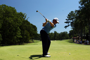 JOHNS CREEK, GA - AUGUST 10:  Lee Westwood of England hits a shot during a practice round prior to the start of the 93rd PGA Championship at the Atlanta Athletic Club on August 10, 2011 in Johns Creek, Georgia.  (Photo by Andrew Redington/Getty Images)