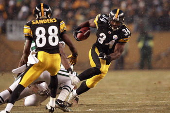 PITTSBURGH - DECEMBER 19:  Rashard Mendenhall #34 of the Pittsburgh Steelers rushes during the game against the New York Jets at Heinz Field on December 19, 2010 in Pittsburgh, Pennsylvania.  (Photo by Karl Walter/Getty Images)