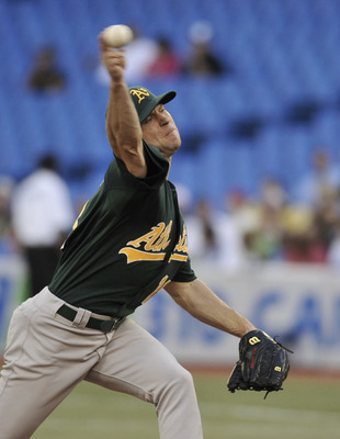 TORONTO, CANADA - AUGUST 9:  Rich Harden #18 of the Oakland Athletics delivers a pitch during MLB game action the Toronto Blue Jays August 9, 2011 at Rogers Centre in Toronto, Ontario, Canada. (Photo by Brad White/Getty Images)