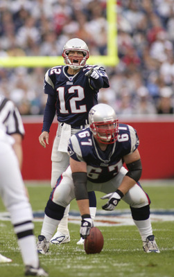 FOXBORO, MA - OCTOBER 10:  Quarterback Tom Brady #12 of the New England Patriots and center Dan Koppen #67 prepare for the snap against the Miami Dolphins during the game at Gillette Stadium on October 10, 2004 in Foxboro, Massachusetts. The Patriots defe