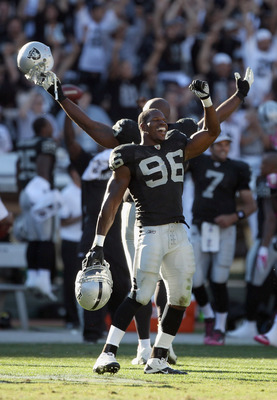 OAKLAND, CA - OCTOBER 10:  Kamerion Wimbley #96 and the rest of the Oakland Raiders celebrate after a replay review ruled that the Tyvon Branch fumble return was a touchdown in the fourth quarter of their game against the San Diego Chargers at Oakland-Ala