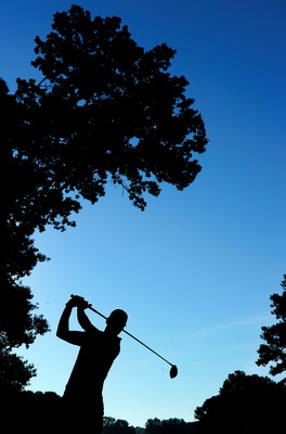 JOHNS CREEK, GA - AUGUST 10:  (EDITORS NOTE: A polarizing filter was used for this image.)  Martin Kaymer of Germany hits a tee shot during a practice round prior to the start of the 93rd PGA Championship at the Atlanta Athletic Club on August 10, 2011 in